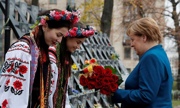 German Chancellor Merkel lays flowers at a monument commemorating the so-called 'Heavenly Hundred' in Kiev