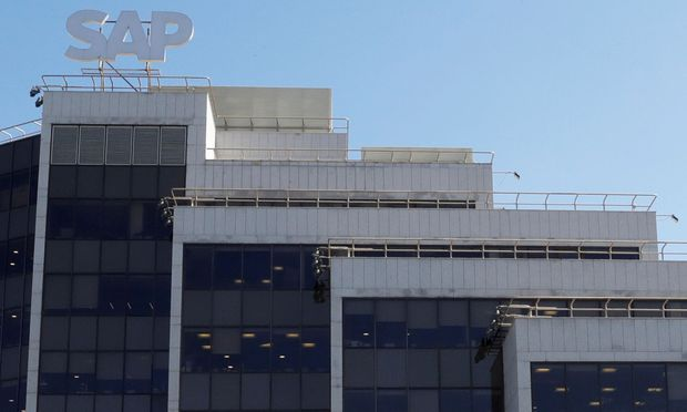 FILE PHOTO: A view shows a sign with the logo of SAP software company on the roof of an office building in Moscow