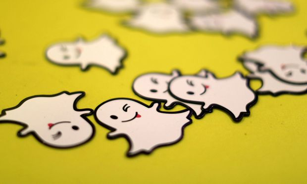 FILE PHOTO: The logo of messaging app Snapchat is seen at a booth at TechFair LA, a technology job fair, in Los Angeles