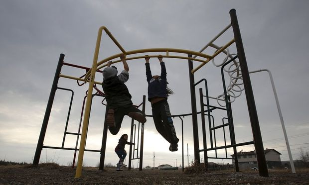 Children play in a playground in the Attawapiskat First Nation
