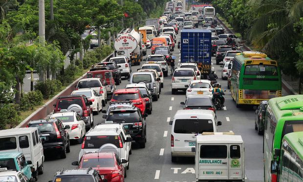 Motorists drive through heavy traffic flow along Roxas boulevard in Metro Manila, Philippines
