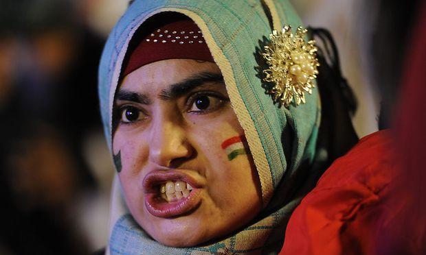 Unterstützer von Tahir ul-Qadri wollen die Regierung in Pakistan stürzen.