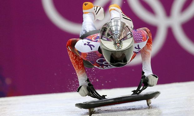Austria's Janine Flock pushes off during the women's skeleton event at the 2014 Sochi Winter Olympics at the Sanki Sliding Center