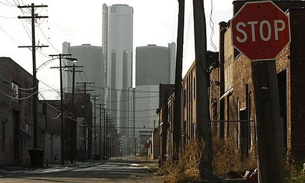 General Motors Corp. headquarters, background, are shown in Detroit, Wednesday, Dec. 10, 2008.  Gener