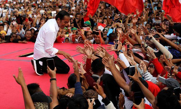 Präsident Joko Widodo setzt diesmal auf die Allianz mit konservativen Muslimen.