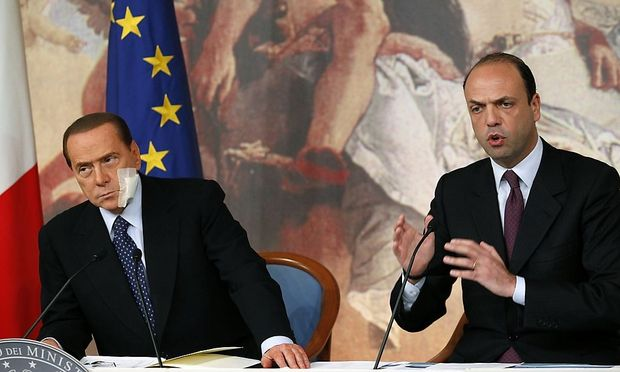 Italian Prime Minister Berlusconi and Italy's Minister of Justice Alfano attend  a news conference announcing reforms for the judicial system at Chigi Palace in Rome