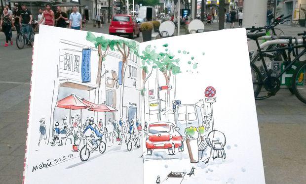 Urban Sketching. Sandra Biskup skizziert eine Szene auf der Mariahilfer Straße.