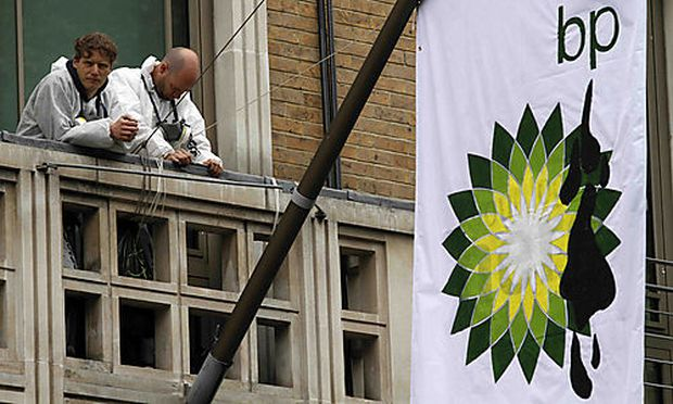 Protesters from the Greenpeace group are seen on a balcony at the BP headquarters in central London T