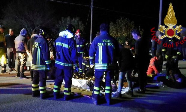 Emergency personnel attend to victims of a stampede at a nightclub in Corinaldo, near Ancona, Italy