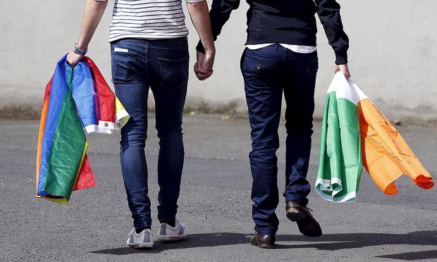 A couple walks hand in hand from the count centre in Dublin as Ireland holds a referendum on gay marriage