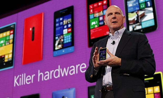Microsoft Corp CEO Steve Ballmer displays a Nokia Lumia 920 featuring Windows Phone 8 during an event in San Francisco