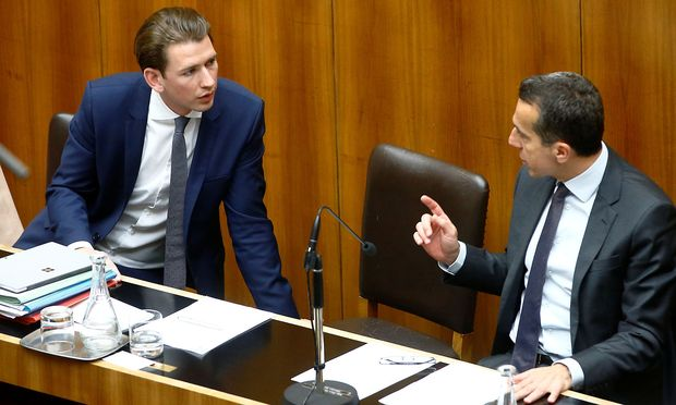 FILE PHOTO: Austria's Foreign Minister Kurz and Chancellor Kern talk in Vienna
