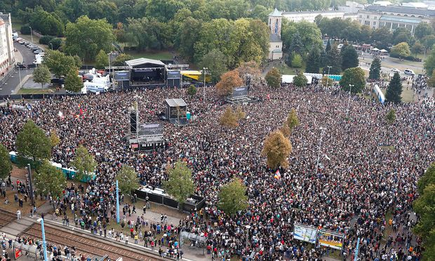 People attend an open air 'anti-racism concert' in Chemnitz