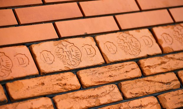 FILE PHOTO: Brick samples are on display outside the headquarters of Wienerberger, the world's biggest brick maker, in Hennersdorf