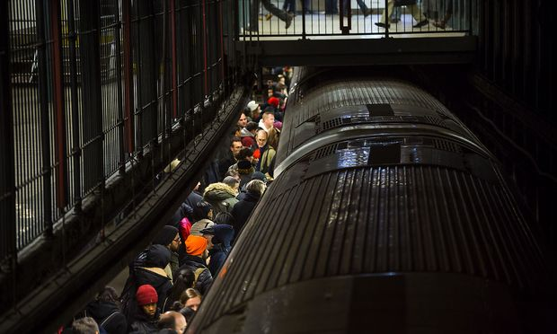 Commuters ride New York City Subway in New York