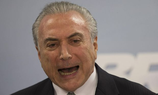 Brazilian President Michel Temer adresses the nation at the Planalto Presidential Palace in Brasilia