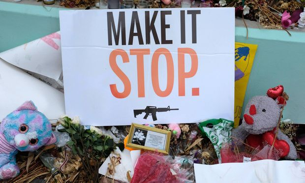 A sign stands in the Marjory Stoneman Douglas High School memorial during a rally for solidarity in