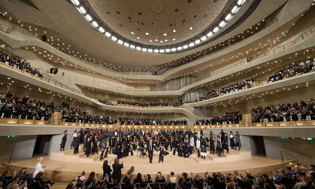 German designer Karl Lagerfeld appears at the end of his Metier d´Art collection show for fashion house Chanel at Hamburg Elbphilharmonie in Hamburg, Germany