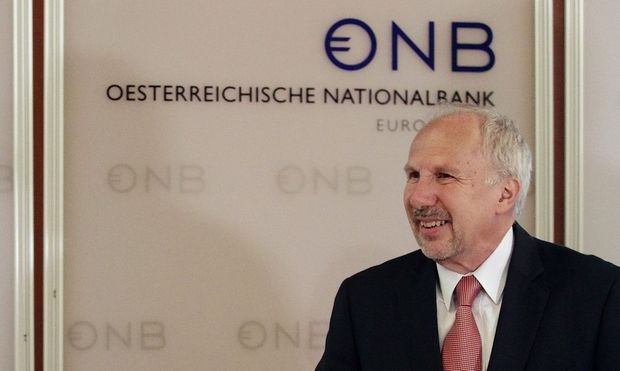 IMF mission head Bakker and Austrian National Bank Governor Nowotny arrive for a news conference in Vienna