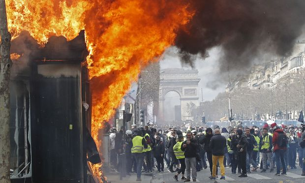 Burning newsagent's is seen during a demonstration by the 'yellow vests' in Paris