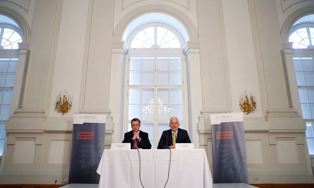 Austrian Justice Minister Josef Moser and Secretary General Christian Pilnacek attend a news conference in Vienna