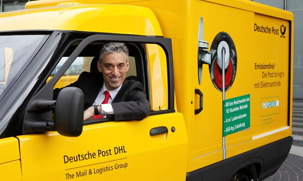 FILE PHOTO: DHL CEO Appel looks out of a StreetScooter E-car in Bonn