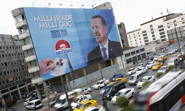 A huge election campaign banner of Turkey´s Prime Minister and presidential candidate Tayyip Erdogan hangs on a building in Istanbul