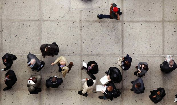 Job seekers stand in line to attend the Dr. Martin Luther King Jr. career fair held by the New York State department of Labor in New York