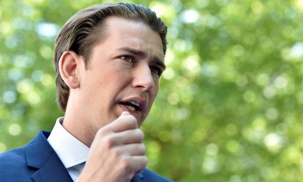 Austrian Chancellor Kurz gestures as he arrives at a European People's Party (EPP) meeting ahead of the EU summit in Brussels