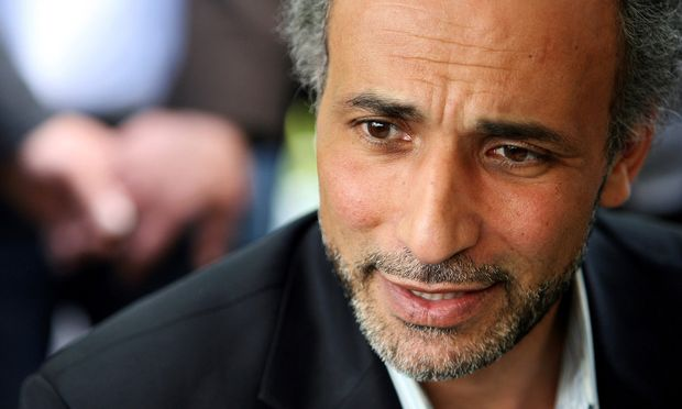 FILE PHOTO: Author Tariq Ramadan talks with a journalist after a conference at the Er-Rahma mosque in Nantes
