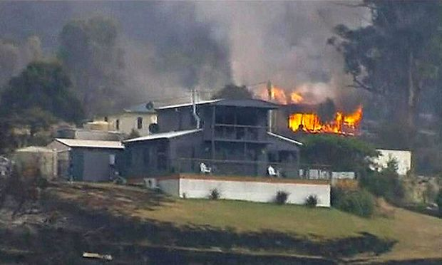 Still image taken from video shows a house on fire in the Tasmanian town of Dunalley