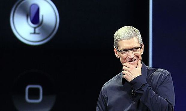 Apple CEO Tim Cook speaks during an event in San Francisco, Wednesday, March 7, 2012.  Apple is expec
