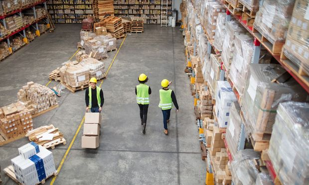 Workers working in large warehouse