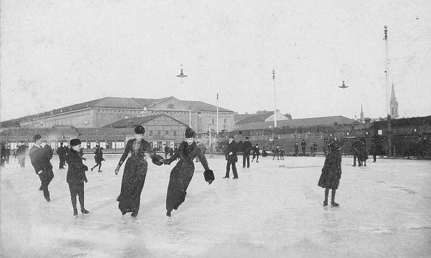 Eislaufen um  1890: Der Eislaufverein an seinem ersten Standort (heute Wien-Mitte). Im Hintergrund die Lagerhalle des Hauptzollamts, rechts die Pfarrkirche St. Othmar unter den Weißgerbern.  / Bild: Wiener Eislauf-Verein
