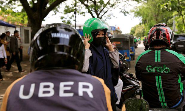 Uber und Grab liefern sich in Rennen um die Gunst der Investoren