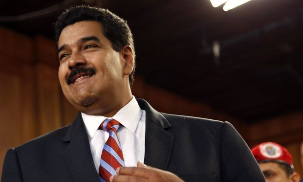 Venezuela's President Maduro smiles during a meeting with ministers and lawmakers of the National Assembly in Caracas