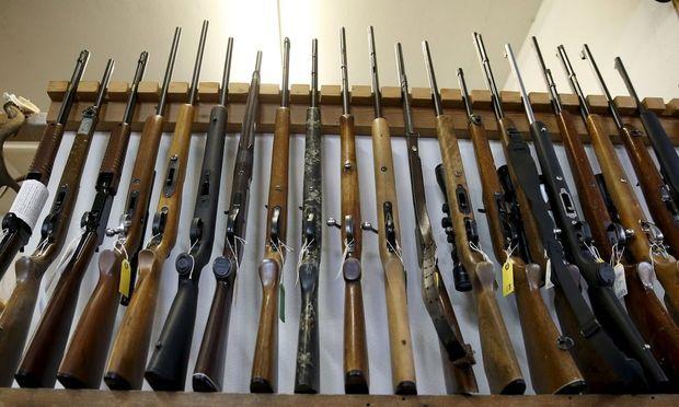 Guns for sale are displayed in Roseburg Gun Shop in Roseburg