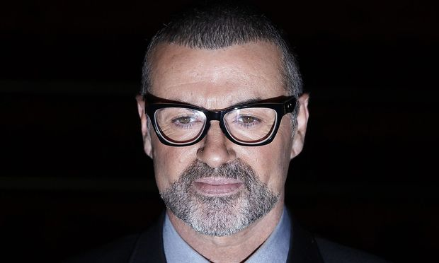 FILE PHOTO - British singer George Michael poses for photographers before a news conference at the Royal Opera House in central London