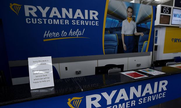 FILE PHOTO: An empty Ryanair customer services desk is seen at Dublin airport in Dublin