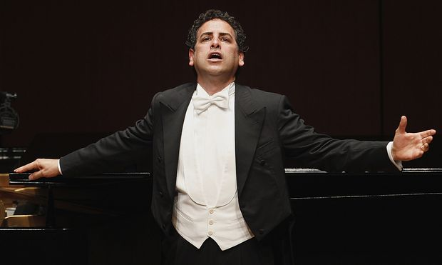 Peruvian tenor Juan Diego Florez gestures during a concert with pianist Vincenzo Scalera at Lima´s National Theatre