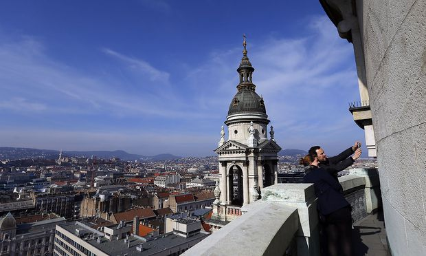 Tourists take a selfie from the balcony of the St Stephen Basilica in Budapest
