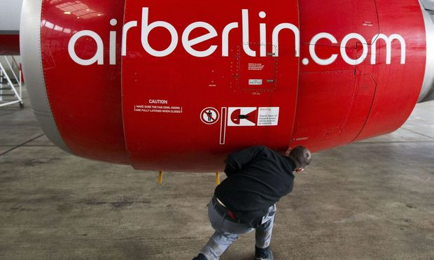 File photo of Air Berlin technician opening cover of jet engine of Air Berlin plane