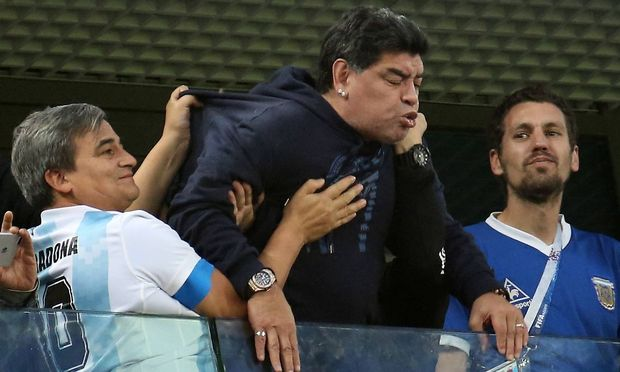 ST PETERSBURG RUSSIA – JUNE 26 2018 Argentinian football star Diego Maradona C during a First S