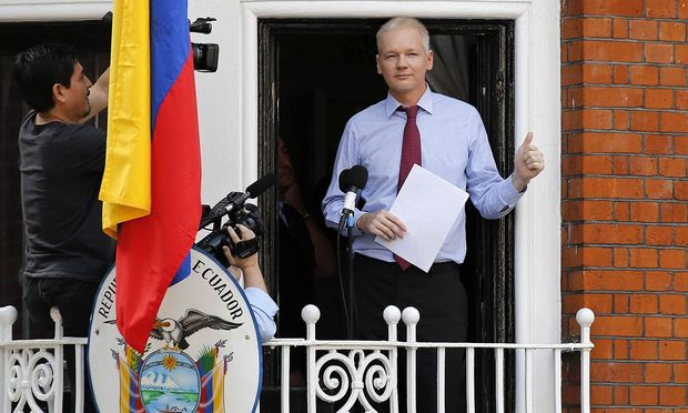Wikileaks founder Julian Assange prepares to speak from the balcony of Ecuador´s embassy, where he is taking refuge in London