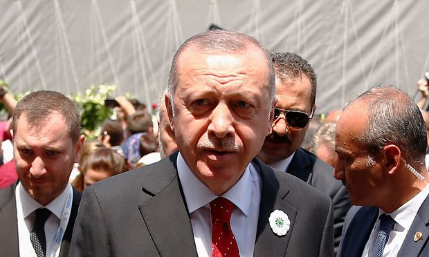 Turkey's President Recep Tayyip Erdogan arrives to pay his respects at a convoy carrying remains of the Srebrenica genocide victims, in Sarajevo