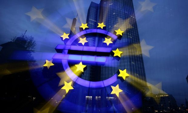 A zoom-burst image shows the illuminated euro sign in front of the headquarters of ECB in Frankfurt