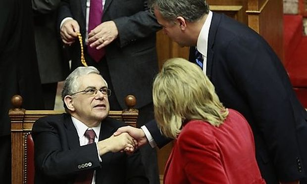 Greek PM Papademos receives congratulations as Greek lawmakers approved a new austerity deal in Athen