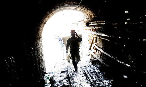 An independent miner enters the Pailaviri zinc-tin mine at the famous Cerro Rico mountain in Potosi,