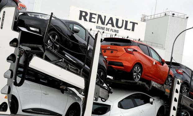 Nissan automobiles are loaded onto a transporter at the Renault SA car factory in Flins