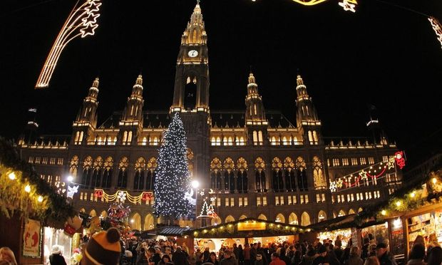 A Christmas tree is illuminated in front of the city hall at the traditional 'Christkindlmarkt' advent market in Vienna